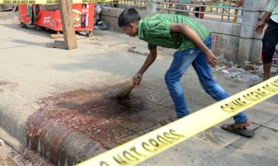 27 Feb 2015, Dhaka, Bangladesh, Bengal --- (150227) -- DHAKA, Feb. 27, 2015 (Xinhua) -- A man cleans up the blood at the site of a murder case at Dhaka University area in Dhaka, Bangladesh, Feb. 27, 2015. Unknown assailants Thursday night hacked a Bangladeshi blogger to death in the capital city of Dhaka. (Xinhua/Shariful Islam) --- Image by © Shariful Islam/Xinhua Press/Corbis